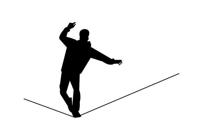 Hombre caminando sobre una cuerda