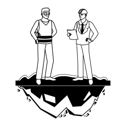 bouwer aannemer met ingenieur op het gazon