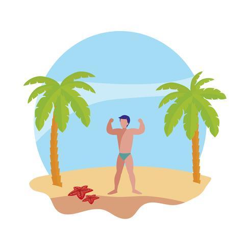 ung stark man på sommarscenen på stranden