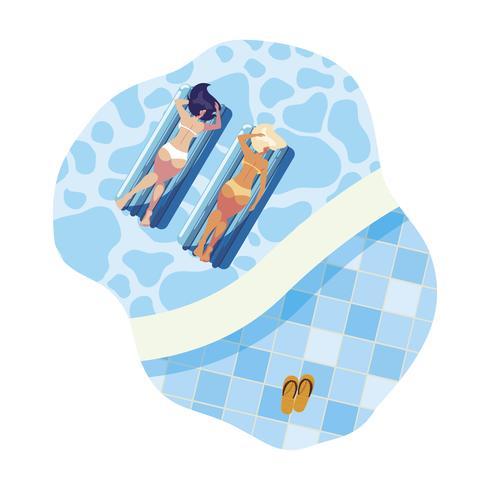 belles filles avec matelas flottant flottant dans l'eau