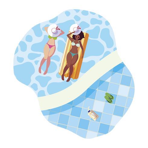 mooie meisjes tussen verschillende rassen die in water drijven