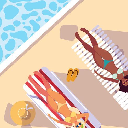 vrouwen met badpak bruinen in het zwembad