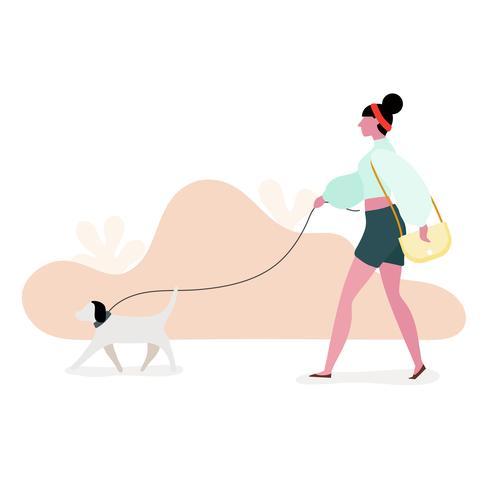 Kvinnor som går hund i parken