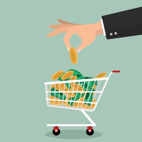 Mano poniendo monedas carro de compras concepto de ahorro de dinero de crecimiento