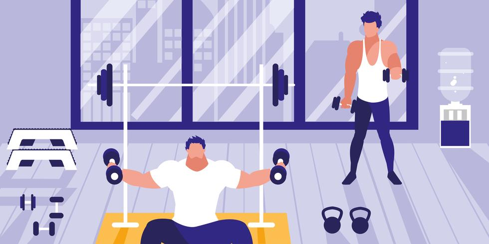 jeunes hommes soulevant des haltères dans la salle de gym