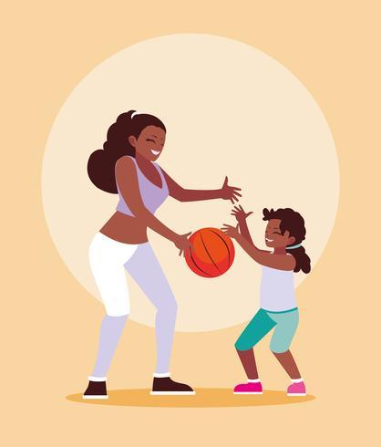 Mutter und Tochter, die Basketball spielen