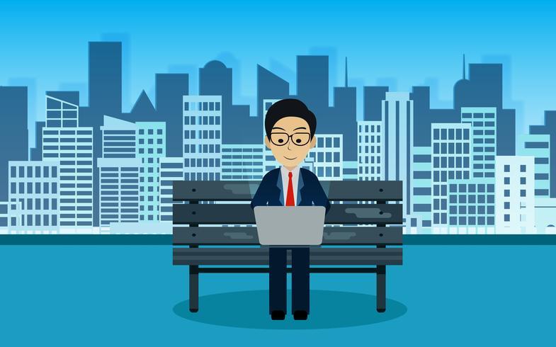 Uomo d'affari che si siede sulla sedia che scrive su un computer