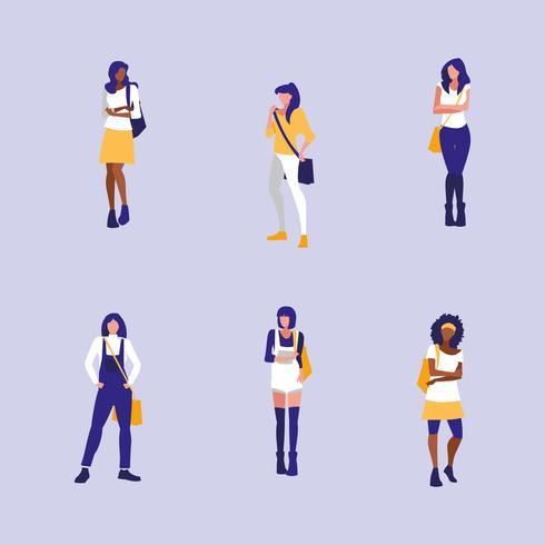 Mädchengruppe, die mit Handtasche modelliert vektor