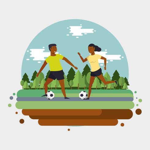 Gente entrenando fútbol en el parque vector