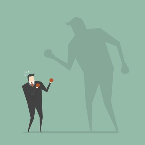 Empresário lutando contra sua sombra