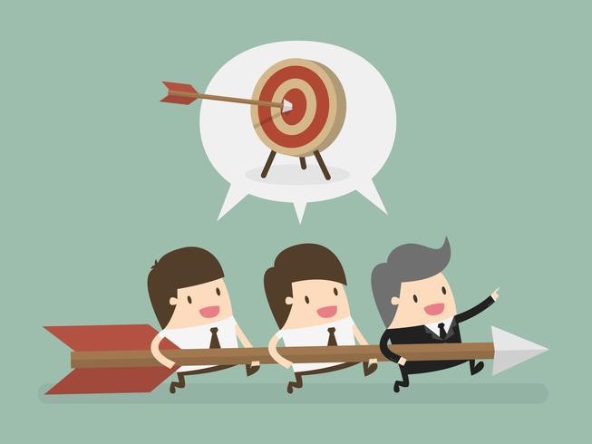 Empresarios con flecha grande corriendo para el objetivo