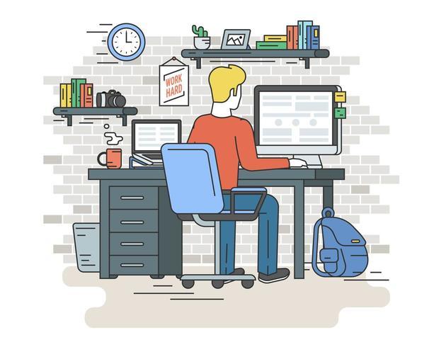 Jovem que trabalha com computador e laptop no interior da casa