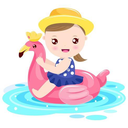 Fille jouant avec anneau de nage flamant rose