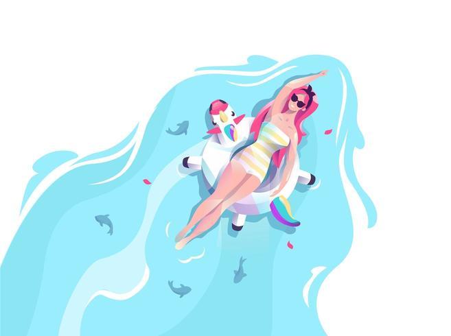 Mulher de unicórnio flutuando na água