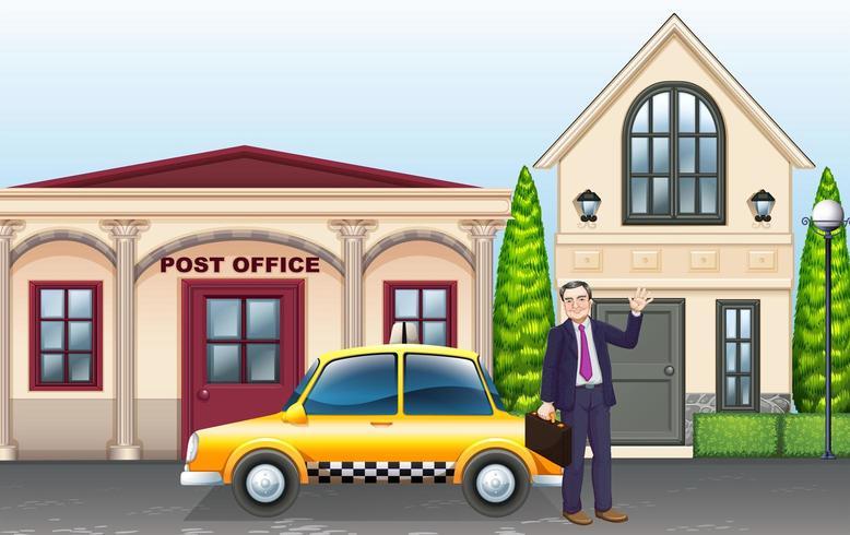 Homem e táxi na frente dos correios