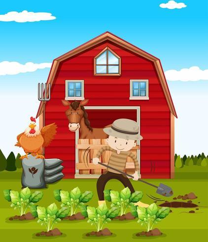 Contadino che lavora nella fattoria