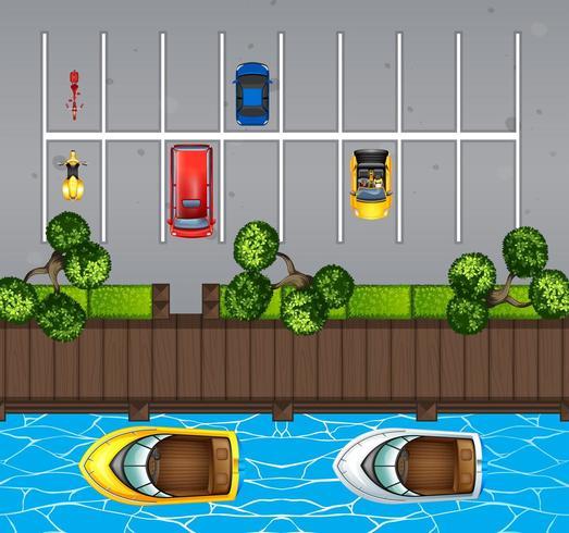 Luftaufnahme des Parkplatzes und des Piers mit Booten