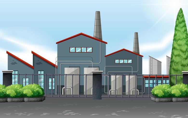 Edificio de la fábrica detrás de una valla metálica vector