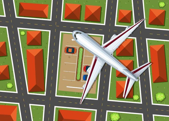 Flygfoto över flygplan som flyger över grannskapet