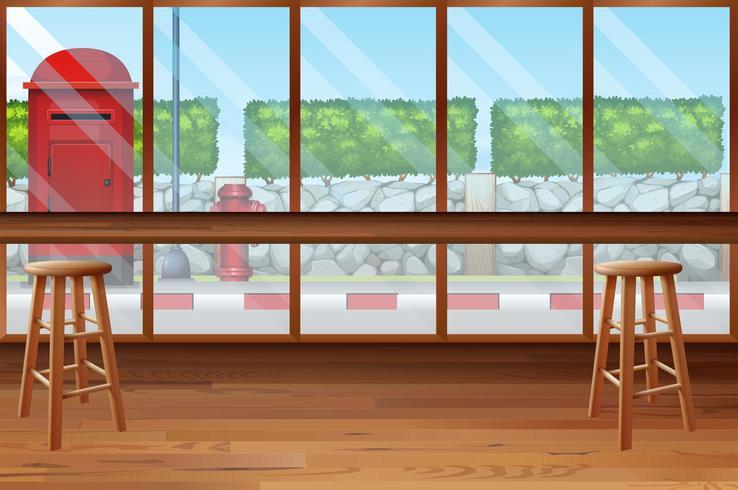 All'interno del ristorante con bar e sedie