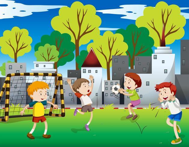 Chicos jugando al fútbol en el campo en la ciudad vector