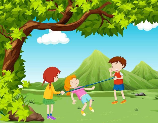 Bambini che giocano a limbo nel parco