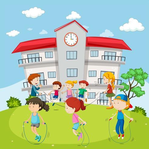 Bambini che saltano la corda davanti alla scuola