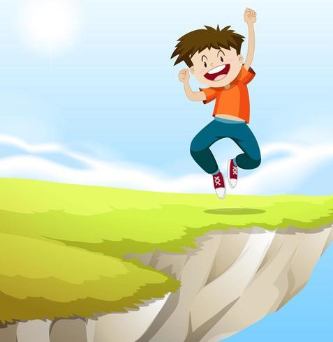 Niño saltando en el acantilado vector