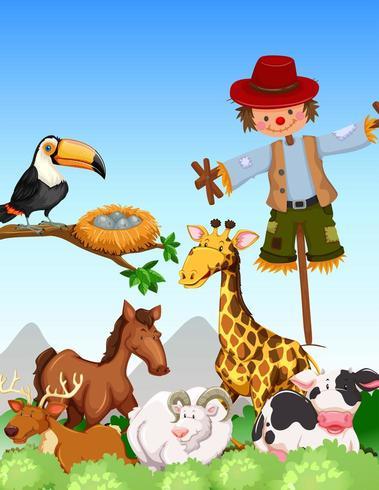 Muchos animales y espantapájaros en un campo