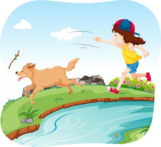 Ragazza che gioca con il cane nel parco