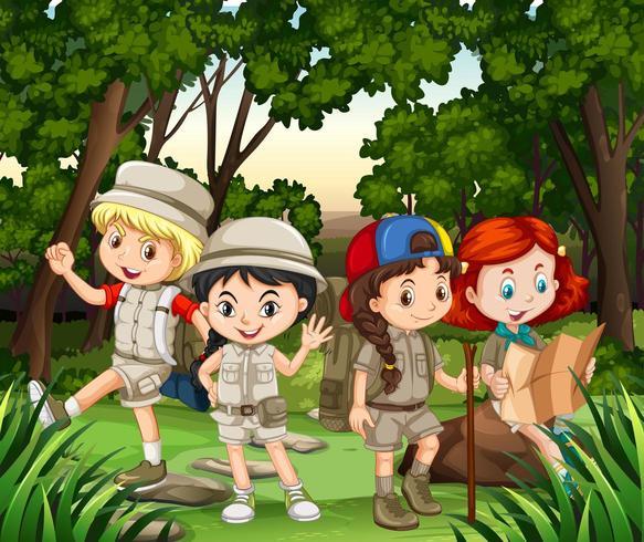 Grupo de niños caminando en el bosque vector