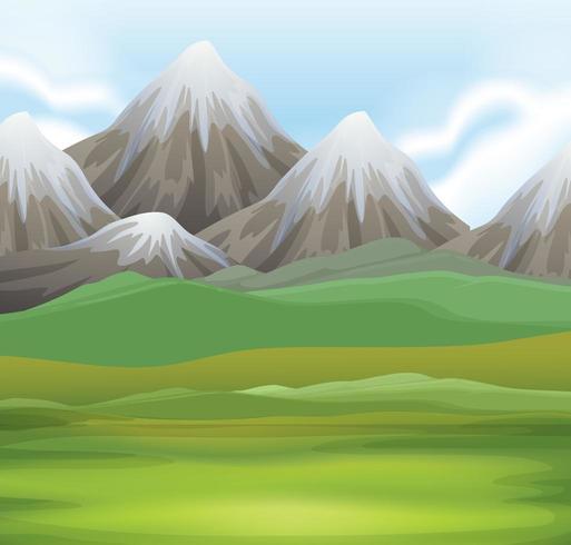 Scena della natura del campo e montagne innevate