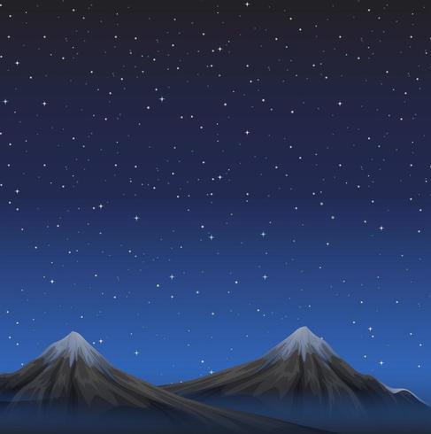 Scène avec des montagnes la nuit sous un ciel étoilé