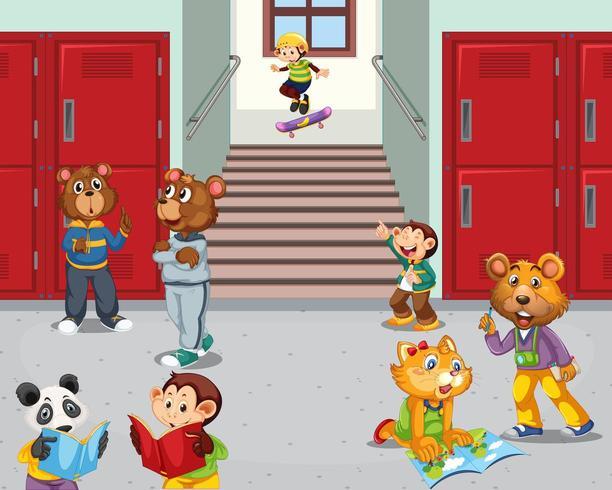 Estudiantes animales en el pasillo de la escuela vector