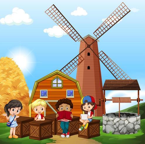 Niños leyendo en la granja vector