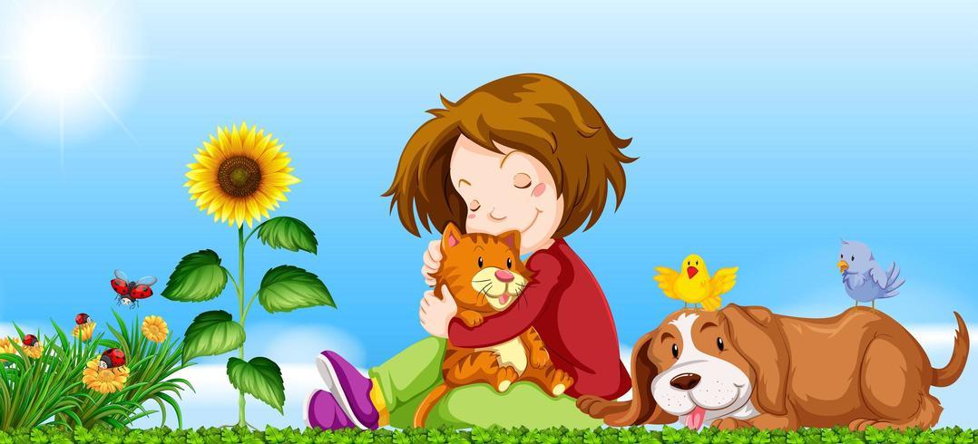 Mädchen und Haustiere im Garten