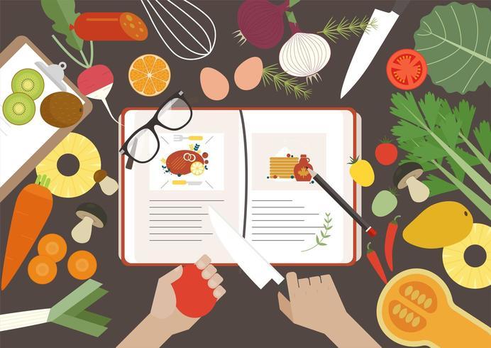 Vista dall'alto del libro di ricette e verdure sul tavolo vettore