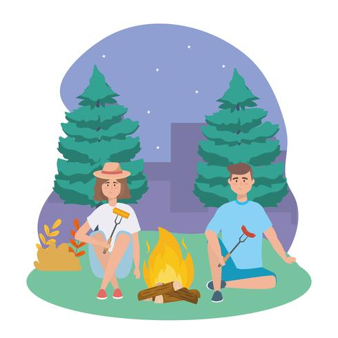 Man and woman with campfire at night
