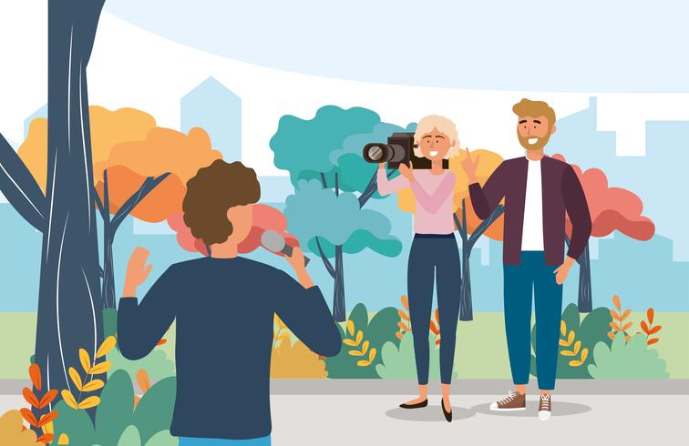 Male reporter with microphone equipment and camerawoman vector