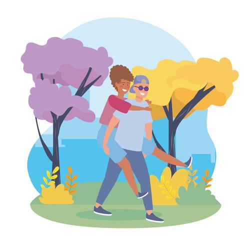 Tragendes Mädchen des jungen Mannes ziehen an sich im Park zurück