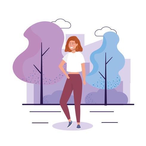 Jonge vrouw met vrijetijdskleding in park