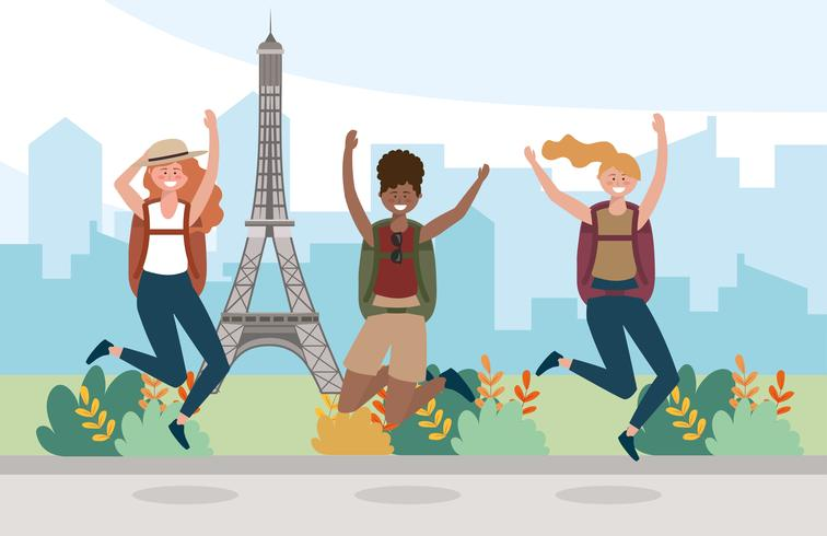 Groep vrouwelijke vrienden die voor de toren van Eiffel springen