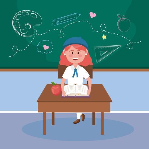 Ragazza con capelli rossi che si siedono allo scrittorio in aula