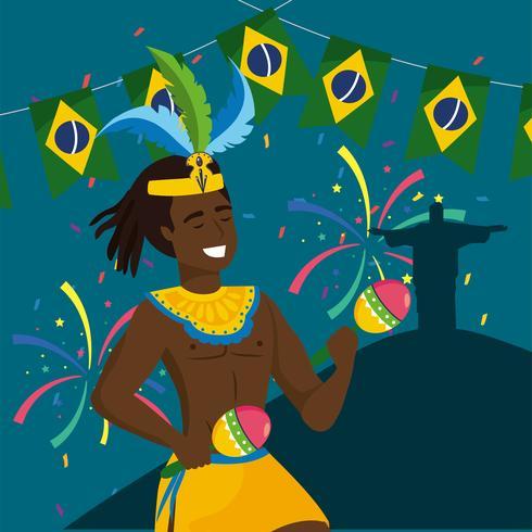 Mannelijke Carnaval-musicus met maracas en de Verlosserstandbeeld van Christus