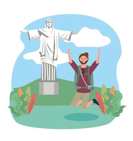 Manlig turist som hoppar framför Kristus förlossarestatyn