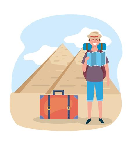 Tourist man with map in front of egyptian pyramids