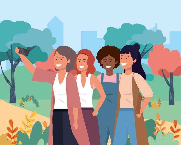 Grupp av olika kvinnor som tar selfie i park