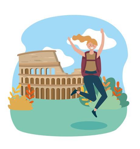 Turista femminile che salta davanti al Colosseo vettore