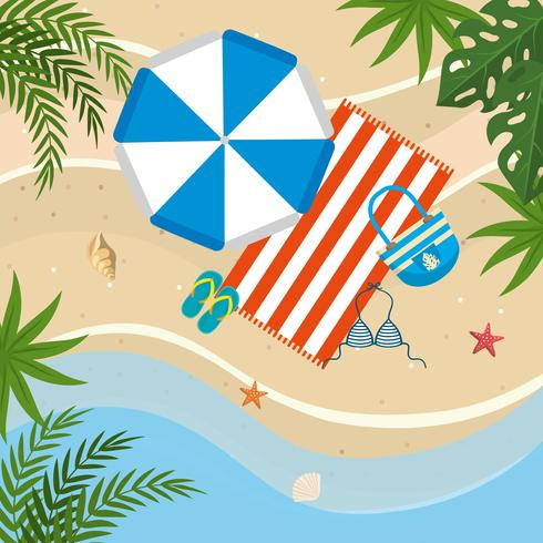 Vista aerea di ombrellone, asciugamano, sandali e costume da bagno sulla spiaggia