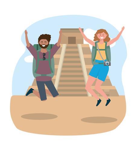 Mannelijke en vrouwelijke toeristen springen voor tempel van inscriptie